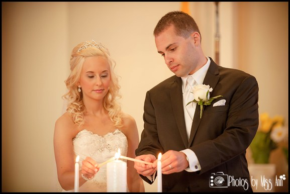 Couple lighting their unity candle Iceland Wedding Photos by Miss Ann