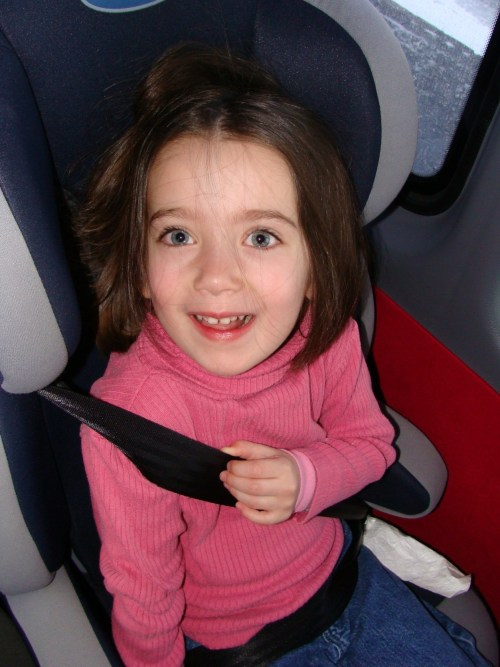 Yes, the seat belt in the featured picture is twisted and should not be! Don't let the belts twist when you strap your children in! This is a good quality high-back booster that was provided to us on a tour bus in 2009.