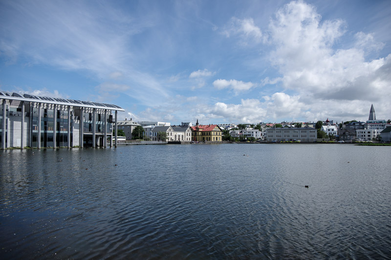 city hall flows into pond