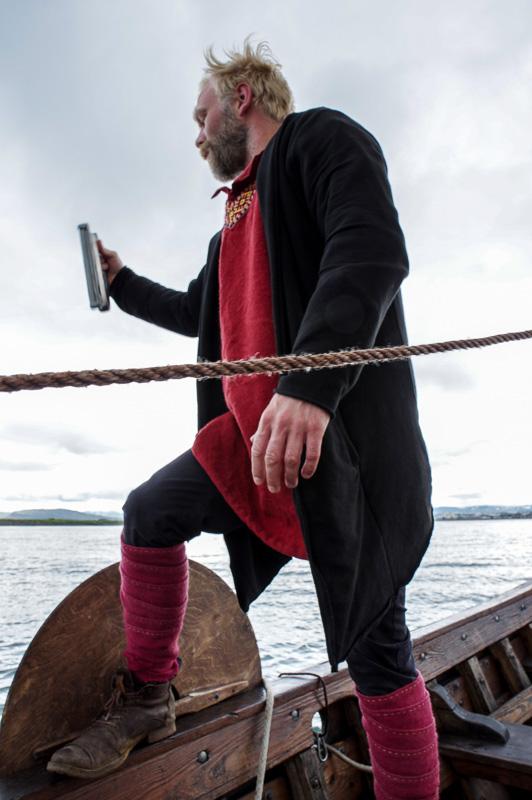 viking boat guide in garb