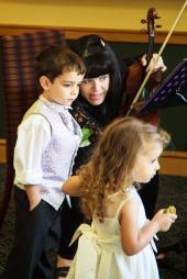 Ariella Strings Cheryl with kids