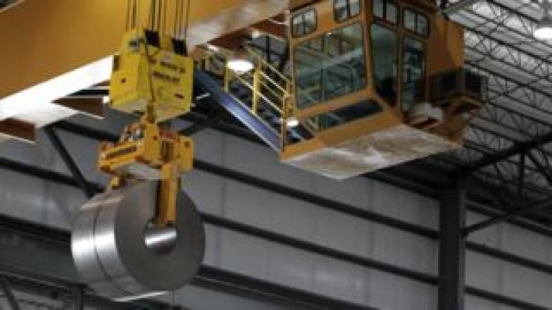 Rolled steel is hoisted by a crane after being treated on the pickle line at Severstal North America plant in Dearborn, Michigan, USA, 21 June 2012