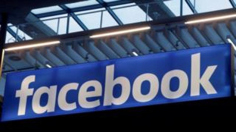 Facebook logo is seen at a start-up companies gathering in Paris