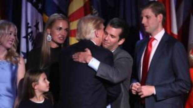 President Trump and son Donald Trump Junior embrace