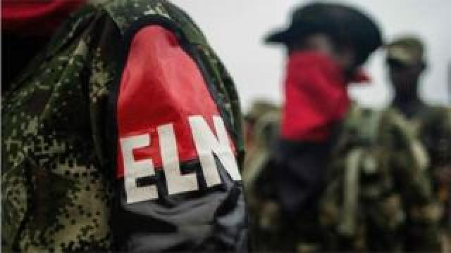"""This file photo taken on November 19, 2017 shows members of the """"Omar Gomez"""" Western War Front of the National Liberation Army (ELN) rebel group lining up in their camp on the banks of the San Juan River, Choco department, Colombia"""