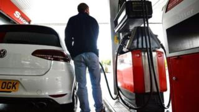 Man filling up his car with petrol