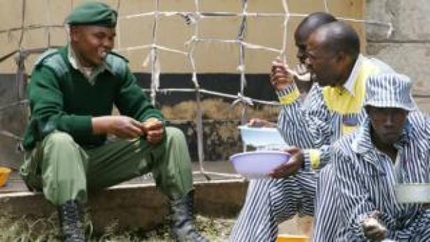 A guard chats to prisoners at Naivasha GK Prison