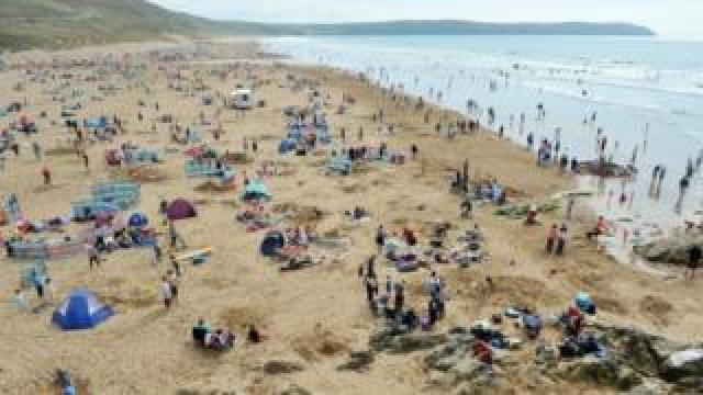 Holidaymakers at Woolacombe, Devon