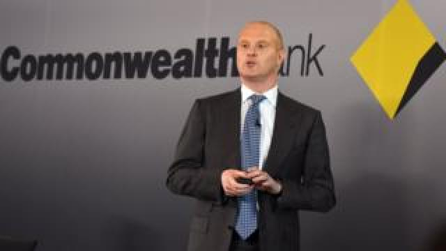 Commonwealth bank head Ian Narev in front of bank logo