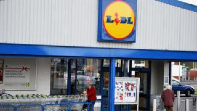 Shoppers outside a Lidl store