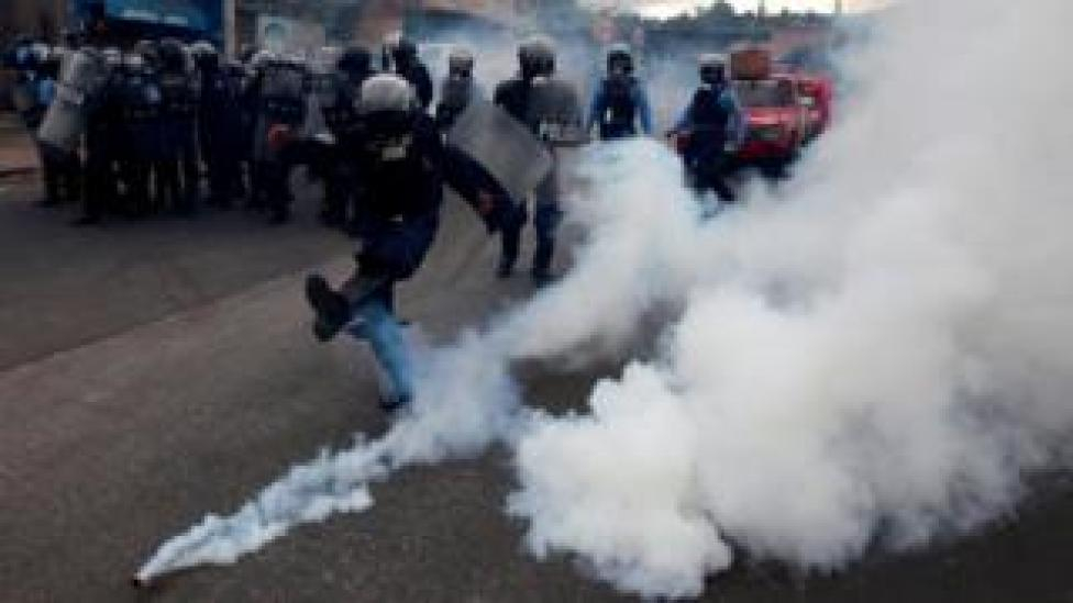 "A riot policeman kicks a tear gas canister to demonstrators, during a protest against the re-election of Honduras"" President Juan Orlando Hernandez in Tegucigalpa Honduras January 20, 2018."