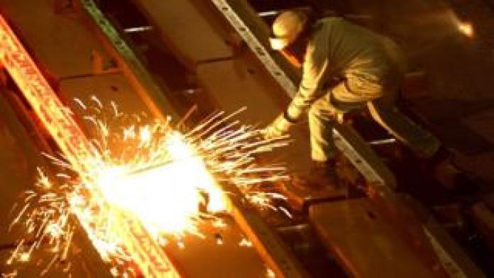 A worker at the Tamco steel mini mill in Rancho Cucamonga, California. October 4, 2002