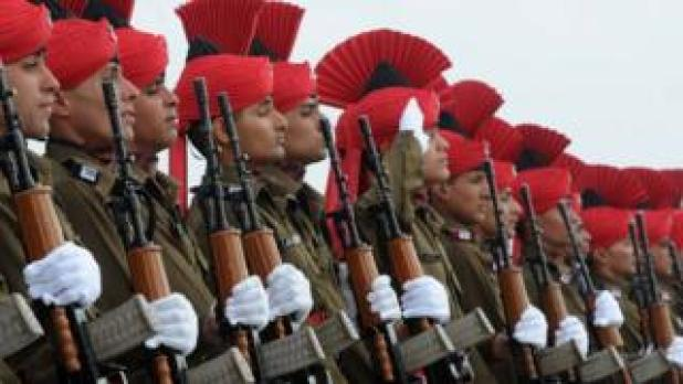 New Indian military recruits stand to attention during a passing-out parade at base on outskirts of Srinagar on March 4, 2015
