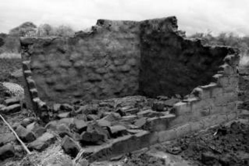 A mud brick house destroyed by heavy rainfall and flooding