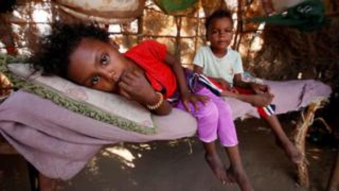 Children rest on a bed at their family hut on the outskirts of the Red Sea port city of Hudaydah, Yemen (12 November 2017)