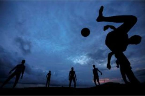 A boy kicks a ball as he plays football with his friends at Galle Dutch Fort in Galle, Sri Lanka, 19 May 2017.