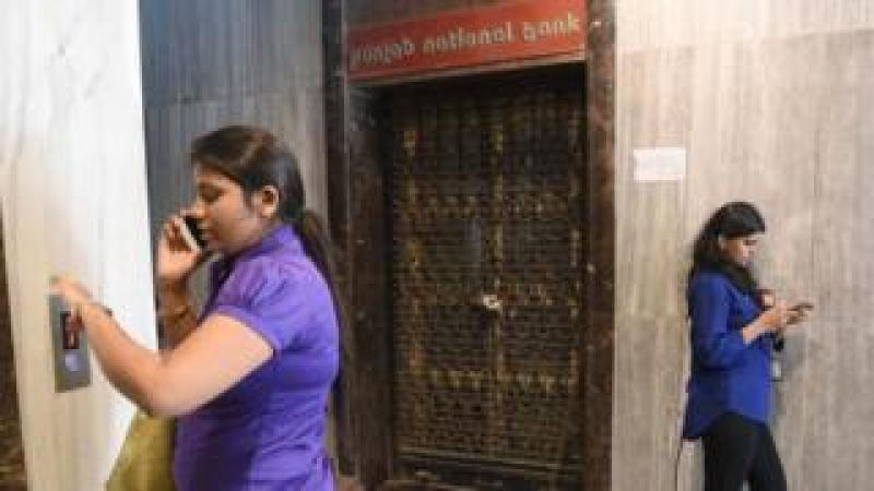 Two women outside closed PNB branch