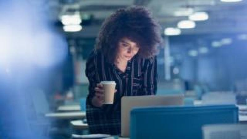 Woman drinking coffee (c) Science Photo Library