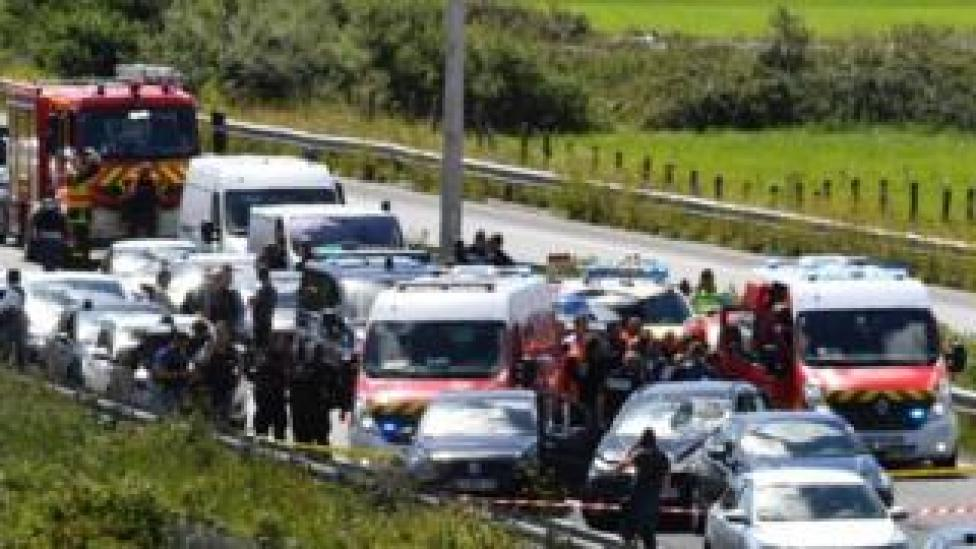 Scene on motorway outside Paris after a BMW driver is shot and arrested following an attack on soldiers earlier in the day, 9 August 2017