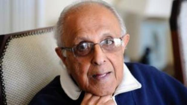 This file photo taken on July 16, 2012 shows Ahmed Kathrada, anti-apartheid activist and close friend of former South African President Nelson Mandela poses in his house in Johannesburg. Kathrada was sentenced with Mandela to life imprisonment on June 12, 1964