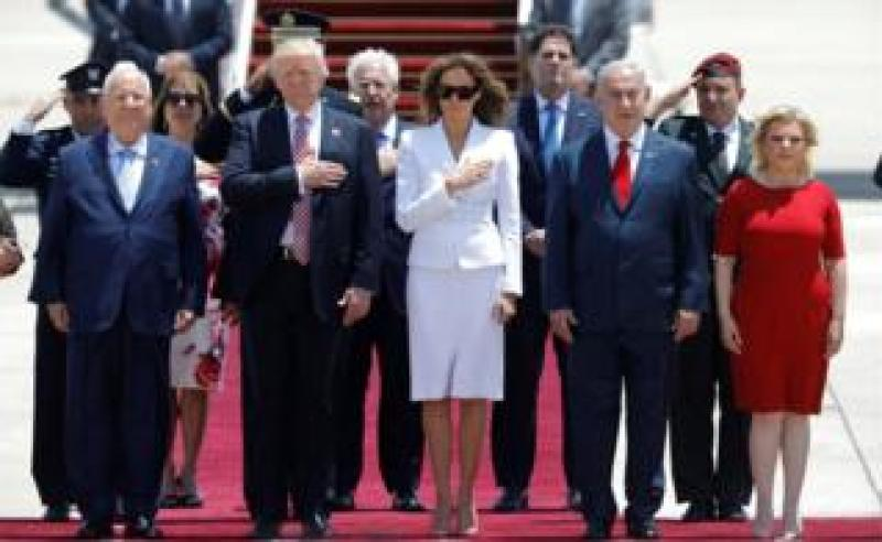 President Donald Trump (2nd L) and First Lady Melania Trump (3rd L) walk with Israeli Prime Minister Benjamin Netanyahu (2nd R), his wife Sara (R) and David Friedman (Center back), the new United States ambassador to Israel, upon their arrival at Ben Gurion International Airport in Lod near Tel Aviv, Israel May 22, 2017