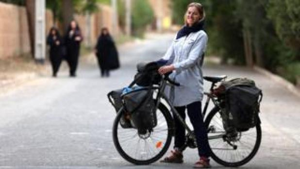 Rebecca Lowe with her bicycle in Iran