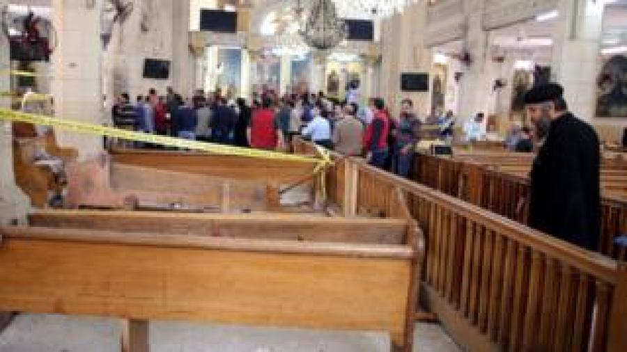 A coptic priest looks on at the damages as security personnel investigate the scene of a bomb explosion inside Mar Girgis church in Tanta, 90km north of Cairo, Egyp