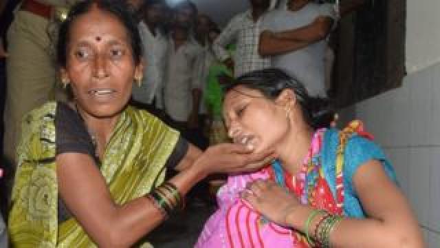 Relatives mourn the death of a children at Baba Raghav Das Hospital in Gorakhpur district of the Indian northern state Uttar Pradesh