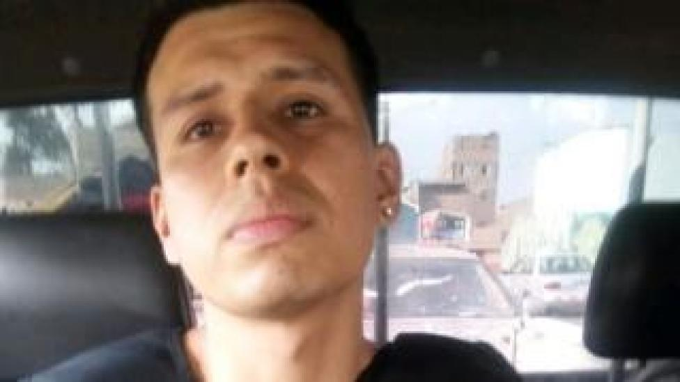 Alexander Delgado in a police car in custody