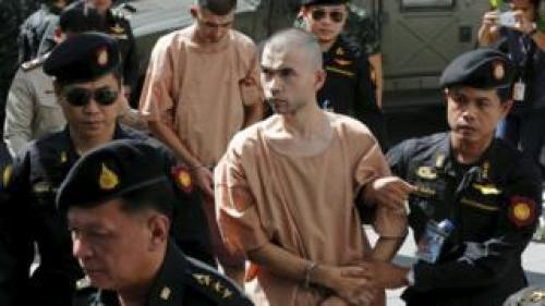 Suspects of the August 17 Bangkok blast, Bilal Mohammed (also known as Adem Karadag) and Yusufu Mieraili are escorted by soldiers and prison officers as they arrive at the military court in Bangkok, Thailand, 24 November 2015