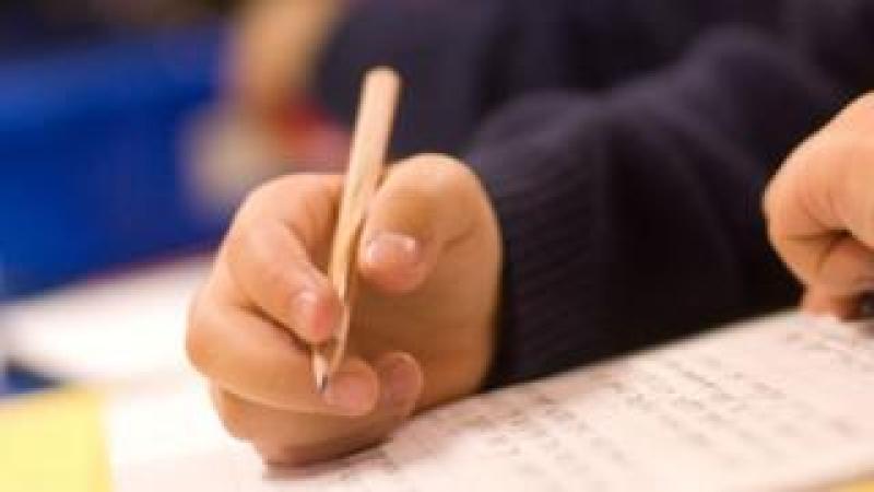 schoolchild holding a pencil