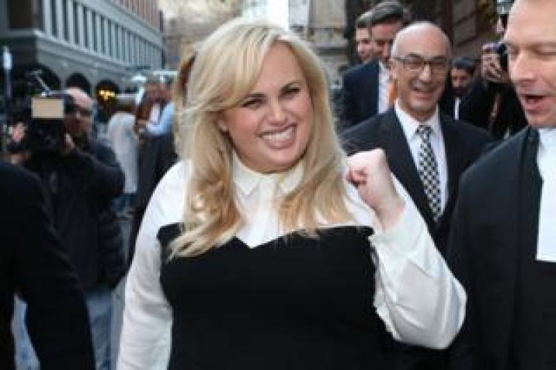 Rebel Wilson celebrates as she leaves court in Melbourne, Australia, in June