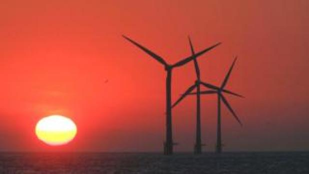 Offshore wind turbines dramatic red sunset