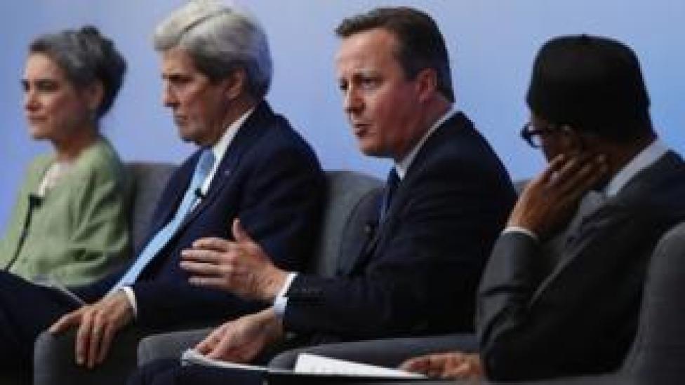 David Cameron on a platform with the US secretary of state, John Kerry, and the President of Nigeria, Muhammadu Buhari