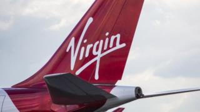Tail of Virgin aeroplane displaying the Virgin logo