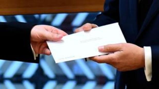 British EU ambassador Sir Tim Barrow delivers the letter to European Council President Donald Tusk
