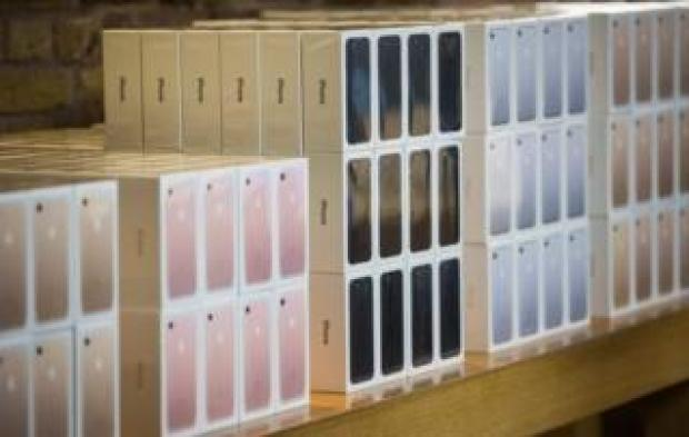 iPhone 7 smartphones pictured in boxes in London on 16 September, 2016.