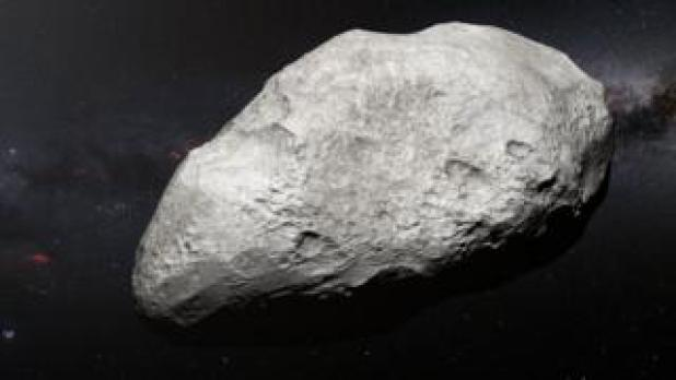Artist's impression of a bright, pitted asteroid in front of a starry sky