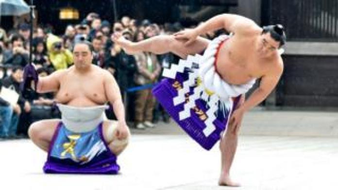 "Sumo Grand Champion Harumafuji Kohei (R)performs ""Dohyo-iri"" (ring purification ritual) during Dezuiri ceremony at the Meiji Shrine on January 8, 2014 in Tokyo, Japan"