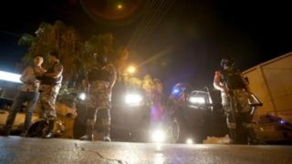 "Security forces stand guard outside the Israeli embassy in the residential Rabiyeh neighbourhood of the Jordanian capital Amman following an ""incident"" on July 23, 2017"