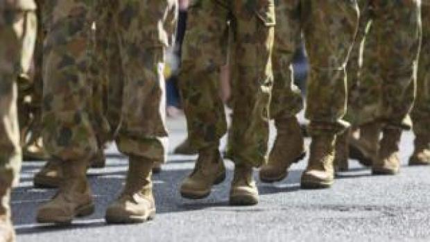 Unidentified Australian soldiers take part in an Anzac Day march