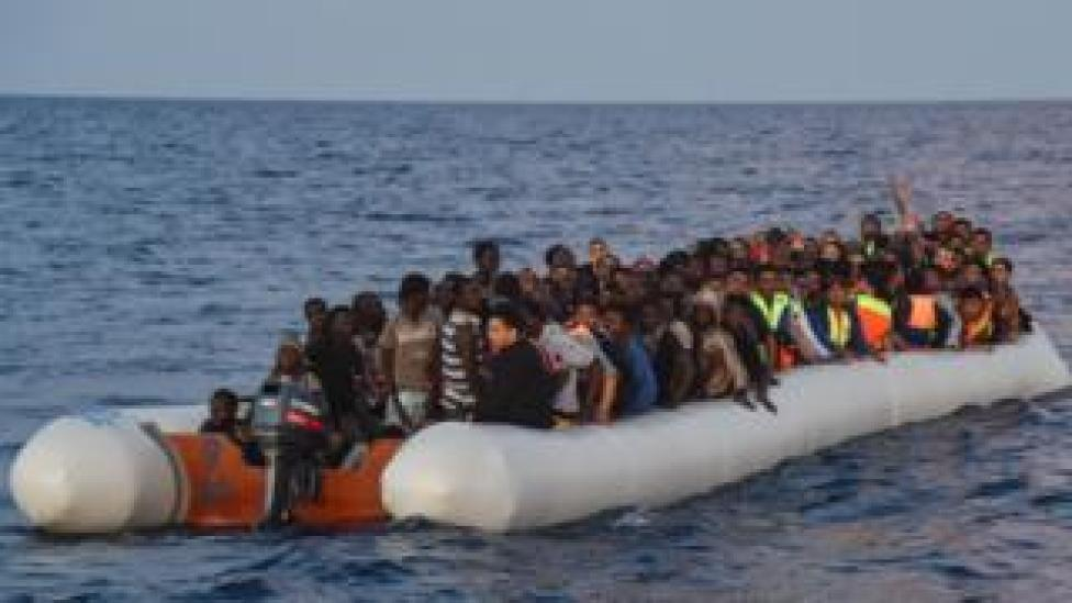 Migrants aboard rubber dinghy off Libya. File photo