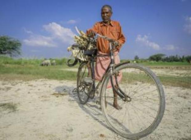 Mr Lal carries the bones on his cycle