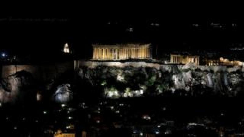 The ancient Parthenon temple is pictured atop the Acropolis hill before Earth Hour in Athens, Greece