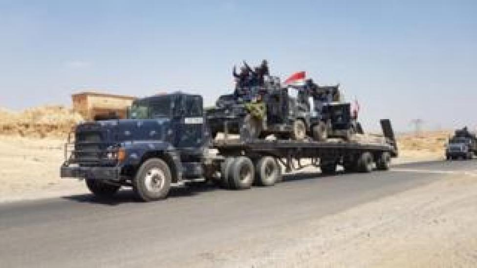 Iraqi armoured vehicles are transported to the frontline outside Tal Afar (15 August 2017