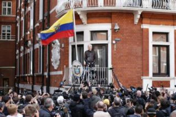 Wikileaks founder Julian Assange speaks on the balcony of the Embassy of Ecuador in London on 19 May 2017. Assange has said he will not forgive and forget attempts to arrest him over rape allegations which led him to seek asylum in Ecuador's London embassy.