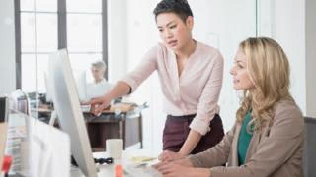 Women at a computer
