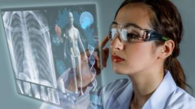 Futuristic doctor looking at body scan