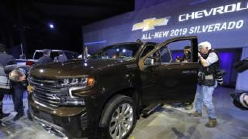 Journalists check out the new 2019 Chevrolet Silverado 1500 after its official debut at the 2018 North American International Auto Show January 13, 2018 in Detroit, Michigan. The show opens to the public January 20th and ends January 28th