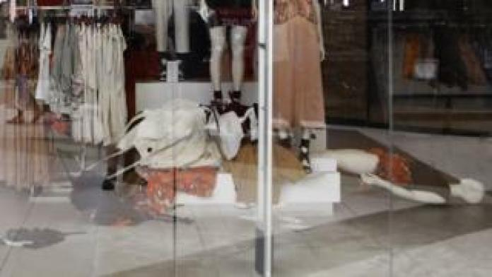 Clothes racks and mannequins lie on the floor of an H&M store after it was shut down by activists from South Africa's EFF party